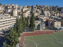 Views of modern buildings and ancient Nazareth Stadium on a sunny day. Stock Photo