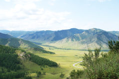 Views of the mountain valley. In the foreground of the mountain valley, and mountain peaks to the horizon Stock Images