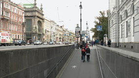 Views of Nevsky Prospekt and the people descending into the underpass. Saint-Petersburg, Russia, 03 October 2016. Group of people coming to the subway in the stock video