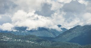 Vancouver Mountain Clouds Timelapse. Views of the North Vancouver British Columbia Canada mountains as clouds pass over them. Great for Tourism and travel stock footage