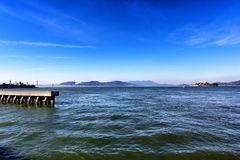 Views from the ocean and pier in San Francisco California. Views from the ocean and pier in San Francisco, California. With blue sky on a sunny day royalty free stock photo