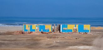 Views of the Ocean in Southern Peru. A few abandoned buildings along an otherwise unspoiled coast of southern Peru stock image