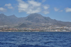 Views over Costa Adeje, Tenerife, Canary Islands. Beautiful views from the ocean towards Costa Adeje resorts, with hotels, entertainment venues, aquatic sports Royalty Free Stock Photo