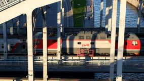 Views passing over the bridge a train of the Russian Railways in St. Petersburg . Russia. 8 may 2016 .Saint-Petersburg.Views passing over the bridge a train of stock video