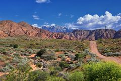 Views of Red Mountain Wilderness and Snow Canyon State Park from the  Millcreek Trail and Washington Hollow by St George, Utah in. Spring bloom in desert royalty free stock images