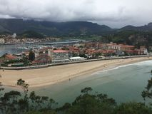 Views of Ribadesella on a cloudy summer day with very low clouds in Spain Asturias royalty free stock photos