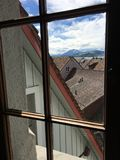 Views of rooftops and Pilatus through the window. royalty free stock photo