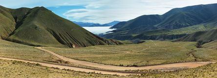 Views from route 13 on its way to Iruya. Salta Province, Argentina. Iruya is under the fog at background Royalty Free Stock Images