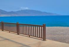 Wonderful views of the sea and wooden railing in Punta de Jandia, Fuerteventura stock photo