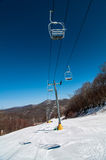 Ski lift. Views from a ski lift during vacation on sunny day royalty free stock images