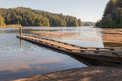 A small wooden jetty on Lake Tahkenitch royalty free stock photography