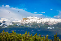 Views of the snow-capped mountain peaks Stock Photos