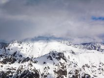Views of snow capped mountains of Dombay. Winter Sunny day, loom Stock Image