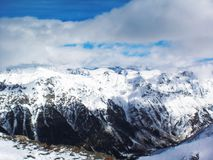 Views of snow capped mountains of Dombay. Winter Sunny day, loom Royalty Free Stock Photo