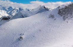 Views of snow capped mountains of Dombay. Winter Sunny day, loom Stock Images