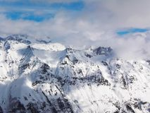 Views of snow capped mountains of Dombay. Winter Sunny day, loom Royalty Free Stock Images