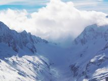 Views of snow capped mountains of Dombay. Winter Sunny day, loom Royalty Free Stock Image