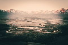 The views of the snowy peaks and the river valley at dawn. stock photos