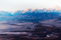 The views of the snowy peaks and the river valley at dawn. stock photography