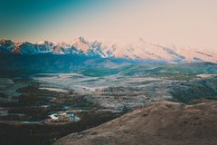 The views of the snowy peaks and the river valley at dawn. stock image