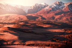 The views of the snowy peaks and the river valley at dawn. royalty free stock photos