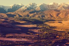 The views of the snowy peaks and the river valley at dawn. royalty free stock photography