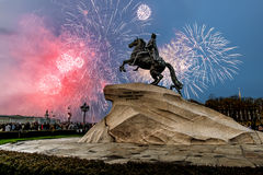 The views of the statue of Peter the Great and the fireworks on. Saint-Petersburg.Russia.May 9, 2014. View of the bronze Horseman and the fireworks on victory Royalty Free Stock Photo