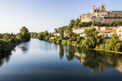 Beziers, France. Views at sunset of the French city of Beziers, with trees, the river Orb, and the 13th-century Cathedral of Saint Nazaire in the background Stock Photography
