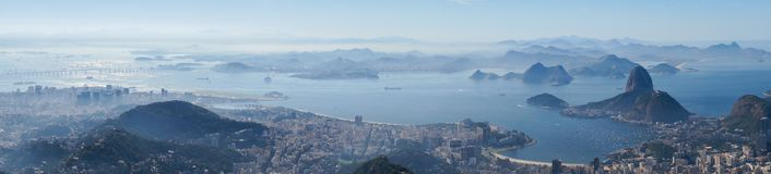 Views to the Rio harbor and Sugar Loaf Mountain from Corcovado in Rio de Janeiro, Brazil.  Royalty Free Stock Images