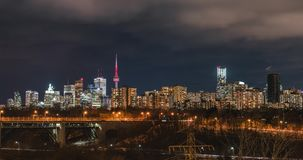 City Modern Skyline Toronto Rush Hour Traffic Timelapse. Views of the Toronto city skyline architecture from Chester Hill Lookout at night stock video