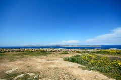Coastal countryside looking towards Gozo, Malta. Views towards Gozo and Comino seen from the Red Fort, Malta, Europe Stock Photo
