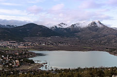 Views of the town and lake with snowy mountains Royalty Free Stock Photos