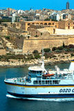 Malta - Manoel Island. View of restored Fort Manoel, Marsamxett Harbour, ferry and skyline of Sliema from St Andrew's Bastion - Valletta, Malta Stock Photo