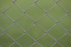 Views from the viewer through a steel mesh Royalty Free Stock Photo