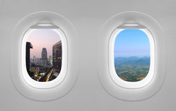 2 views window plane. City and mountain views window plane Stock Illustration