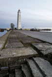 Views of the Wooden lighthouse in kronstadt at sunset.St. Peters Stock Photography