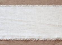 Vifta med säckvävbakgrund, stycke av naturligt material, kan användas som bakgrund Fotografering för Bildbyråer