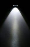 Viga de la linterna del LED en el papel. Fotografía de archivo