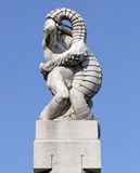 Vigeland park, Oslo, Norway, a man wrestling with a lizard. Stock Images