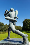 Vigeland statue woman and man walking. OSLO - AUGUST 27: Statues in Vigeland park in Oslo, Norway on August 27, 2012. The park covers 80 acres and features 212 Stock Image