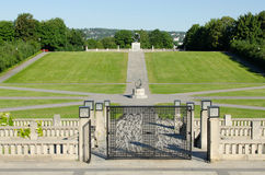 Vigeland sundial and gate. OSLO - JUNE 21: Statues in Vigeland park in Oslo, Norway on June 21, 2012. The park covers 80 acres and features 212 bronze and Stock Photography
