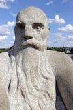Vigelandpark, Oslo, Noorwegen, het hoofd van een kale oude mens met een grote baard Stock Foto
