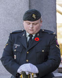 Vigil. A Canadian reservist stands vigil at a war memorial  in Glace Bay, Nova Scotia, Canada on Remembrance Day, November 11, 2014. Memorials nationally marked Royalty Free Stock Photo