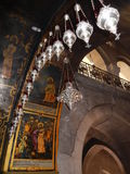VIGIL LAMPS AND  BIBLICAL SCENES, CHURCH OF THE HOLY SEPULCHRE Stock Photography