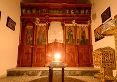 Vigil light Panagia Stratolatissa chapel. KYTHNOS, GREECE - AUGUST 14, 2014: Vigil light burning in front of the iconostasis (templon) in the chapel next to the Royalty Free Stock Images