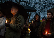 Vigil for Newtown shooting victims. Dozens of Vermonters gathered at City Hall Park in Burlington Vermont for a candle light vigil held in honor of the victims Stock Photos