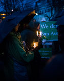 Vigil for Newtown shooting victims. Dozens of Vermonters gathered at City Hall Park in Burlington Vermont for a candle light vigil held in honor of the victims Royalty Free Stock Photo