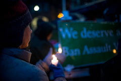 Vigil for Newtown shooting victims. Dozens of Vermonters gathered at City Hall Park in Burlington Vermont for a candle light vigil held in honor of the victims Stock Image