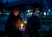 Vigil for Newtown shooting victims. Dozens of Vermonters gathered at City Hall Park in Burlington Vermont for a candle light vigil held in honor of the victims Royalty Free Stock Photography