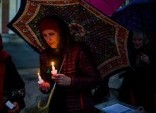 Vigil for Newtown shooting victims. Dozens of Vermonters gathered at City Hall Park in Burlington Vermont for a candle light vigil held in honor of the victims Royalty Free Stock Image